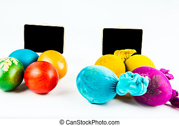With and without clothes - Two groups of Easter eggs, with...