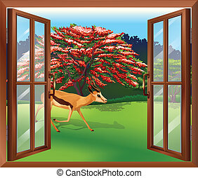 A window with a view of the deer outside