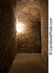 underground stone corridors in the ruins of ancient castle