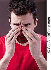 Man having sinus pain - Young man complaining about having...
