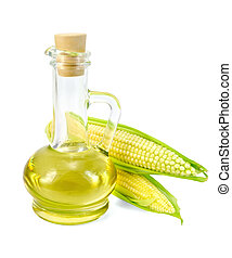 Corn oil in a carafe with two cobs - Corn oil in a glass...