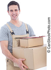 messenger in dungarees with a lot of boxes - delivery man...