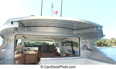 Main deck of luxury yacht on sunny day, with sliding roof