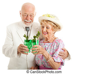 Kentucky Derby Day Juleps - Southern senior couple enjoying...