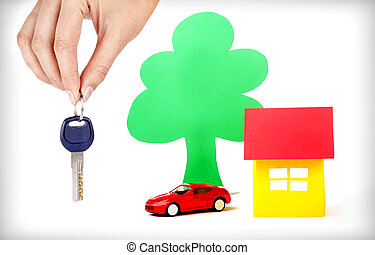 Real Estate sale - Hand with keys and car drawings and the...