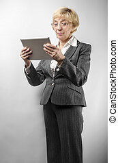 Woman with tablet pc - Attractive woman 50 years old with a...