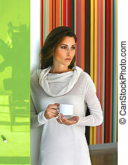 Relaxed beautiful woman drinking coffee