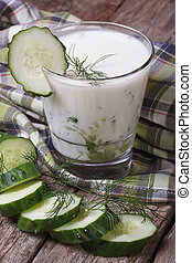 Greek yogurt with cucumber and dill close-up on the table....