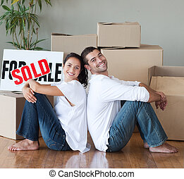 Couple Having Bought New House - Young Couple relaxing after...