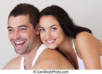 Wife embracing her husband