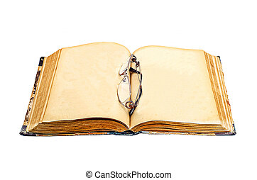 Book and glasses - The opened book and glasses on the book...
