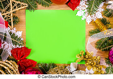 Christmas frame for congratulations and green paper