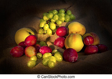 Fruits - Light painting of mixed fruit on a rustic cloth