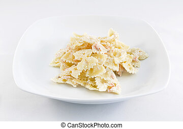 Pasta - Farfalle pasta with salmon on a white background