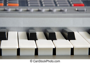 Electra Toning - Pictures of black and white keys of a...