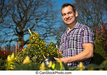 Farmer or gardener looks at bush with berries - Farmer or...