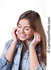 Teenager listening music - Teenager is happy because of...