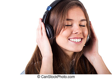 Pretty girl listening to music - Pretty young girl listening...