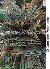 A series of different sizes metal pipes on shelf Metal pipe...