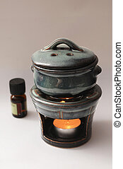 Aromatherapy Burner - A green-and-black clay aromatherapy...