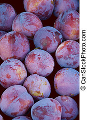 Plums for sale at a farmers market in Switzerland