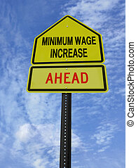 monimum wage increase ahead - conceptual sign with words...