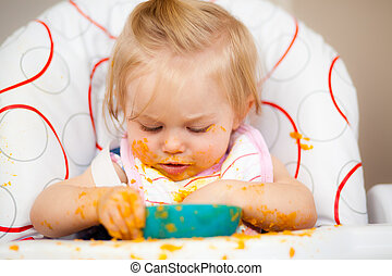 Messy - Little girl having a messy lunch