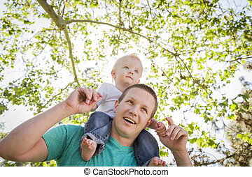 Cute Young Boy Rides Piggyback On His Dads Shoulders