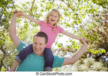 Cute Young Girl Rides Piggyback On Her Dads Shoulders...