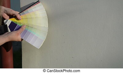 color scale match wall - Hands with color scale palette...