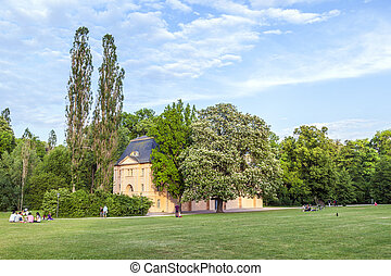 people relax in the ilmpark - WEIMAR, GERMANY - MAY 27:...