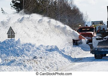 Snowplow removing snow from intercity road from snow...