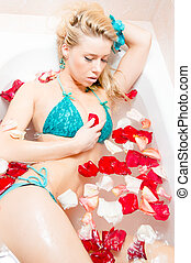 spa relaxation: Young beautiful woman in turquoise swimsuit...