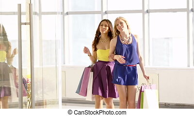 Showing new clothes - Charming girls paying attention to new...
