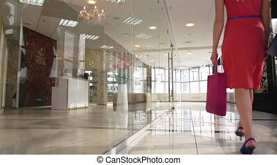 Shoppers in the mall - Group of friendly females walking...