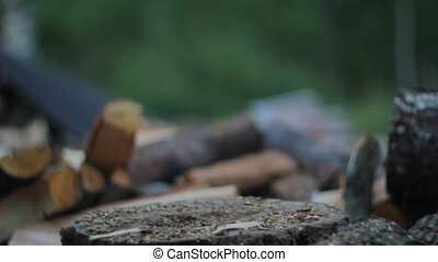 Chopping Firewood at Dusk - High quality video of a man...