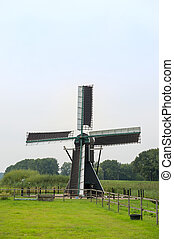 Dutch windmill near the river - Dutch windmill at the river...