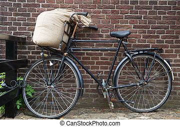 Bicycle from the miller with jute bag flour