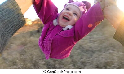 Man Rotates His Little Daughter Outdoor, First Person View...