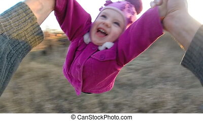 Slow Motion. Man Rotates His Little Daughter Outdoor, First...
