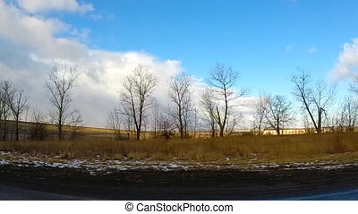 Spring Driving View with Last Snow, Dramatic Blue Skies and...