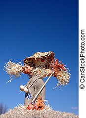 scarecrow on blue background
