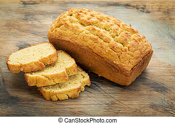 gluten free bread - slices and loaf of freshly baked, gluten...