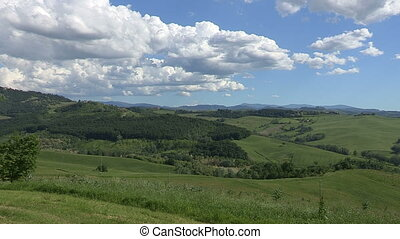 View of the Italian countryside in spring, with hills and...