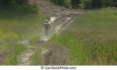 Cyclist going down on dirt patch - Female cyclist going...