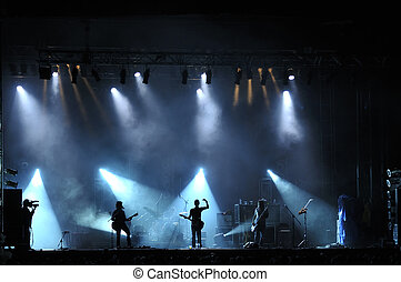 Rock concert live on stage outside silhouette of singers on...