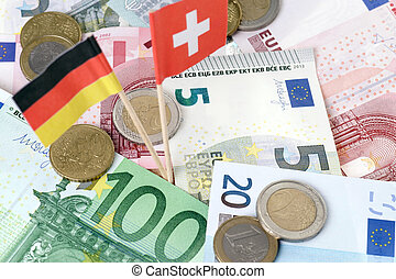 tax sinner - euro banknotes and swiss and germany flag