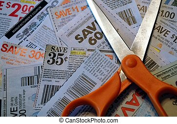 Cutting Coupons - A scissors has done a great job of cutting...
