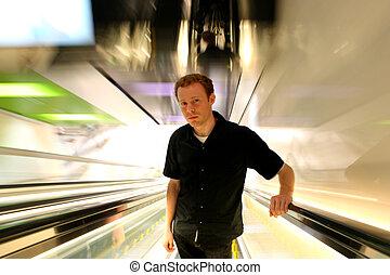 Postmodern Man - Man in 20s looking apprehensive, ascending...
