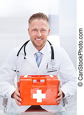 Doctor or paramedic in a white lab coat with a stethoscope -...